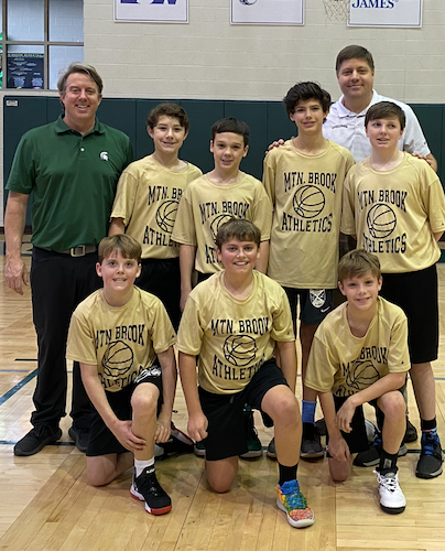 Josh (far left) with his 50th team coached, a youth basketball team